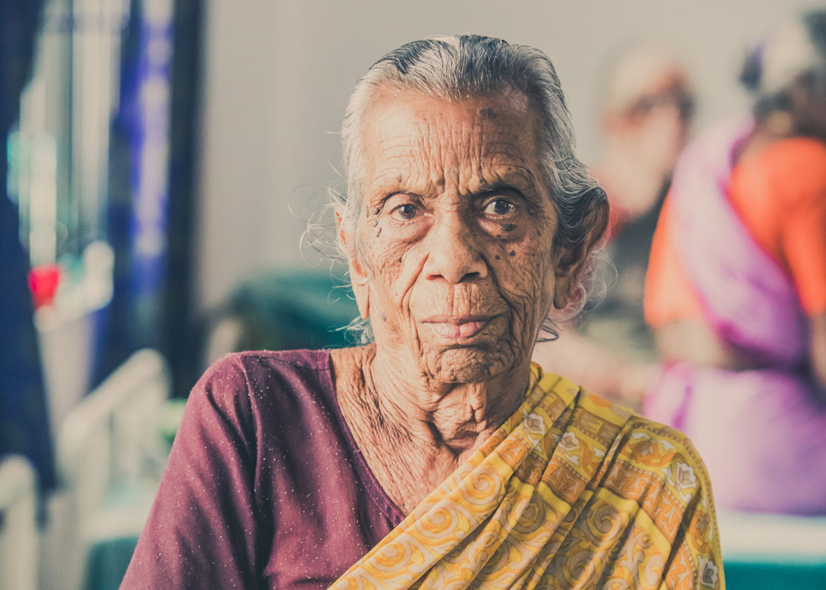 a woman with leprosy poses for a picture for embrace a village