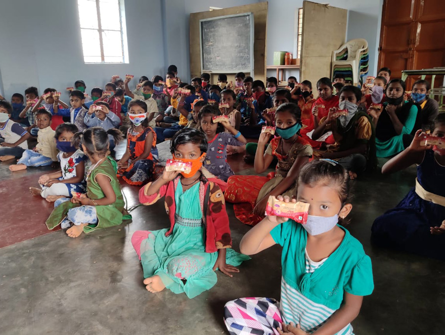 kids at embrace a village try out the power bar nutritional bar